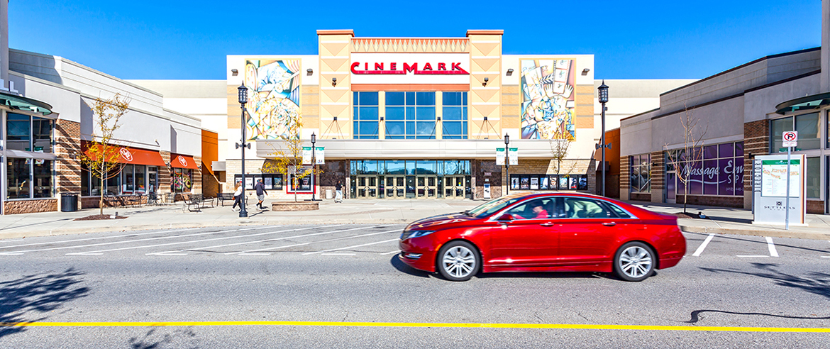 Cinemark, Qdoba, Massage Envy storefronts at Settlers Ridge
